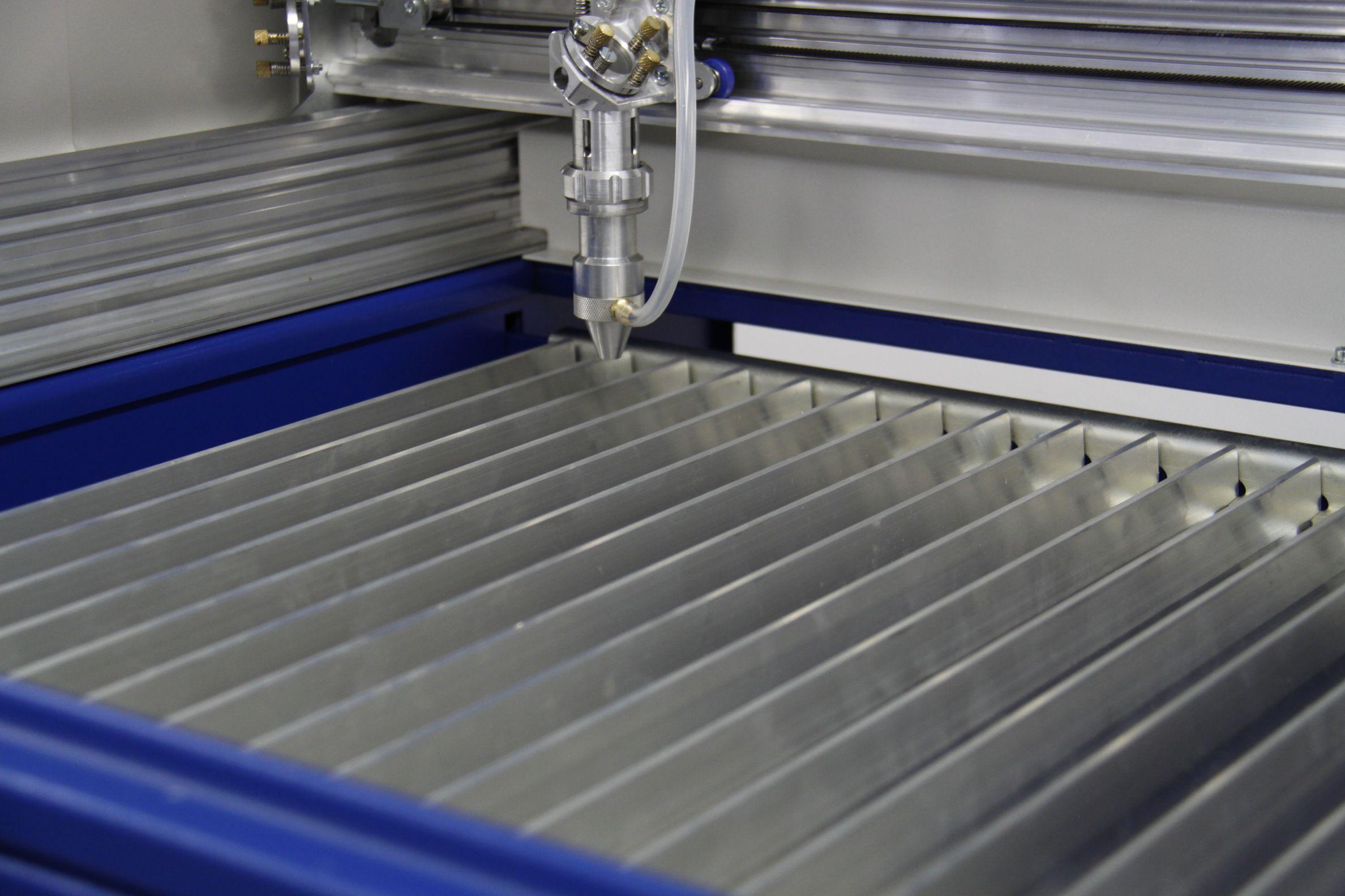 TMX65 laser machine work area - bar bed